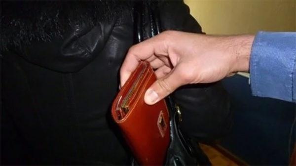 вор карманник